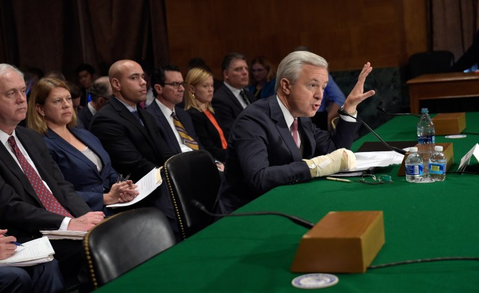 Wells Fargo Chief Executive Officer John Stumpf testifies on Capitol Hill in Washington, Tuesday, Sept. 20, 2016, before Senate Banking Committee. Stumpf was called before the committee for betraying customers' trust in a scandal over allegations that employees opened millions of unauthorized accounts to meet aggressive sales targets. (Susan Walsh/AP)
