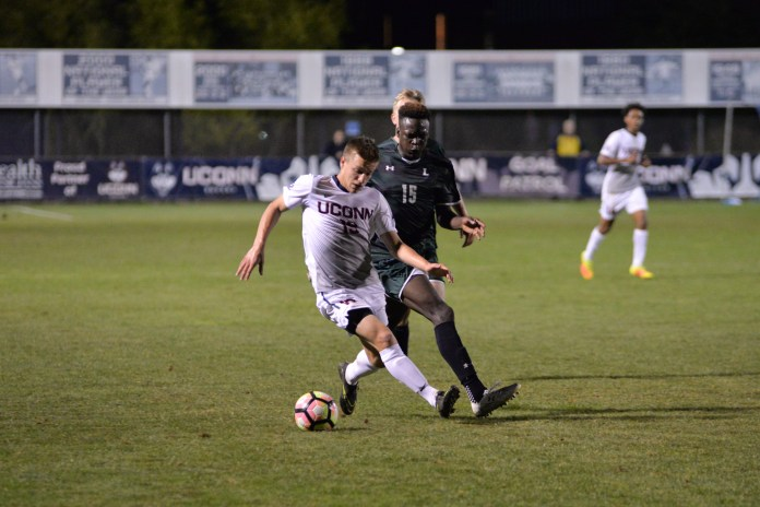 UConn freshman midfielder Niko Petridis dribbles past a Loyola midfielder during the Huskies 5-1 victory over Loyola at Morrone Stadium on Saturday, Sept. 17, 2016. The Huskies will take on the Rhode Island Rams on Wednesday. (Amar Batra/The Daily Campus)
