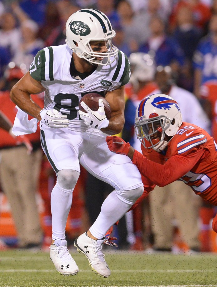 New York Jets wide receiver Eric Decker (87) is hit by Buffalo Bills defender Kevon Seymour (29) during the second half of an NFL football game Thursday, Sept. 15, 2016, in Orchard Park, N.Y. (Adrian Kraus/AP)