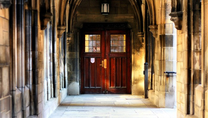 The University of Chicago, of which doors near the Bond Chapel are pictured above, was in the spotlight recently after the dean released a statement on trigger warnings and the university's policy against them. A new survey shows that half of U.S. professors use trigger warnings. ( Phil Roeder /Creative Commons)