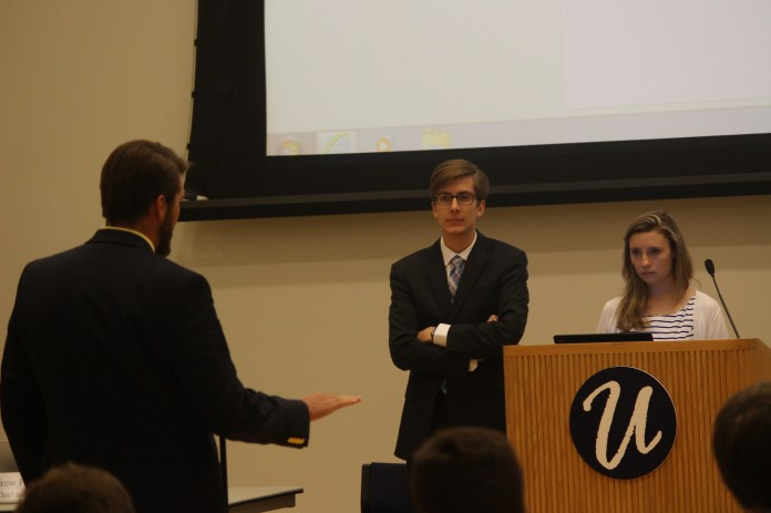 Undergraduate Student Government President Dan Byrd and Lysette Johnson, funding board chair,passes a funding bill on Wednesday, Sept.21, 2016 (Mustafe Mussa/Daily Campus)