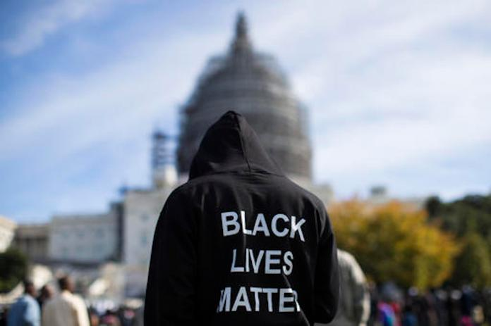 The support from young white adults is an increase from the beginning of the summer and the first time in the poll a majority of black, white, Hispanic and Asian young adults expressed support for the Black Lives Matter movement. (Evan Vucci/AP)