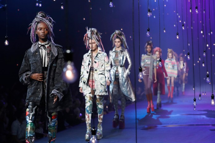 """In this Sept. 15, 2016, file photo, the Marc Jacobs Spring 2017 collection is modeled during Fashion Week in New York.Jacobs was criticized for showcasing white models in dreadlocks during the show. A screengrab showed Jacobs later responding on Instagram that he doesn't see color or race. In a separate post on Sunday, Sept. 18, 2016,Jacobs said he was sorry for """"the lack of sensitivity"""" in responding to critics. (Mary Altaffer/AP Photo)"""