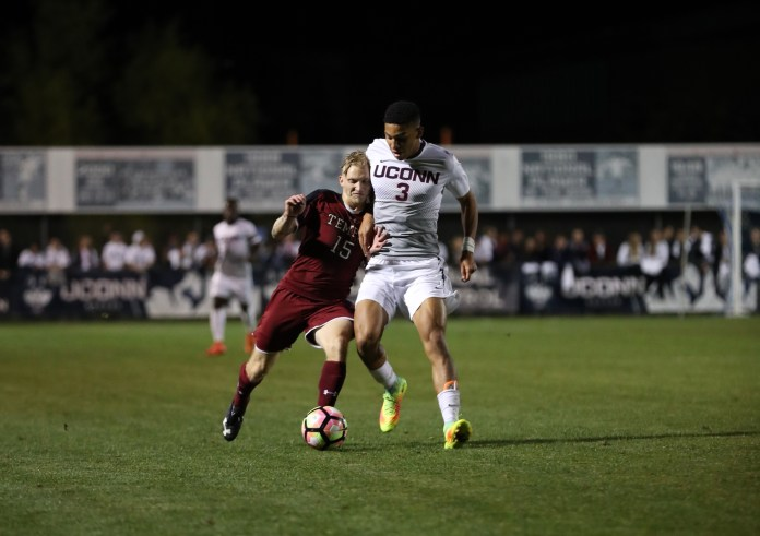 Defensive player  Jacob Hauser-Ramsey goes up against a Temple opponent on Saturday, Sept. 24 in the 1-0 win at Joseph J. Morrone Stadium. (Ruohan Li/The Daily Campus)