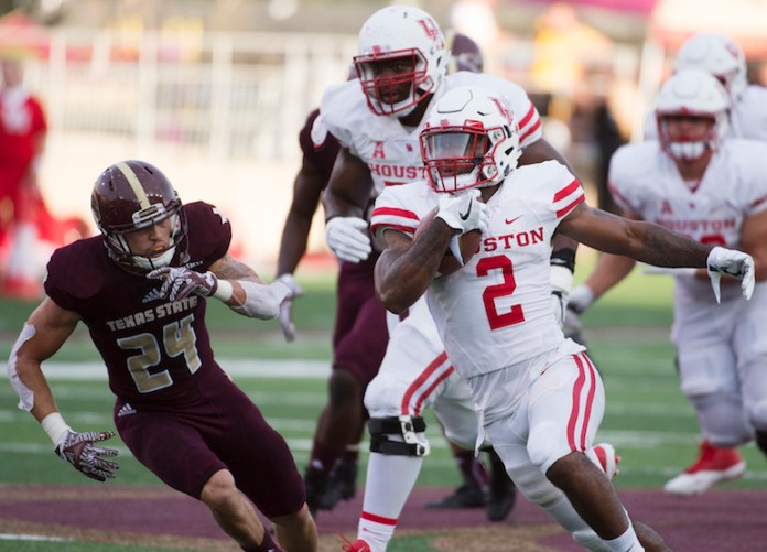 Houston running back Duke Catalon (2) evades Texas State safety Javante O'Roy during the first half of an NCAA college football game, Saturday, Sept. 24, 2016, in San Marcos, Texas.Houston won 64-3. (Darren Abate/AP Photo)