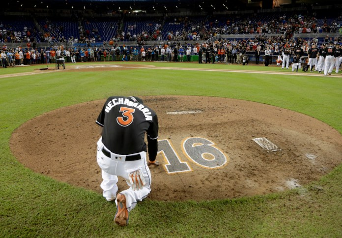 Miami Marlins' Adeiny Hechavarria (3) touches the pitcher's mound with the number 16 in honor of Marlins pitcher Jose Fernandez, after a baseball game against the New York Mets, Wednesday, Sept. 28, 2016, in Miami.(Lynne Sladky/AP Photo)