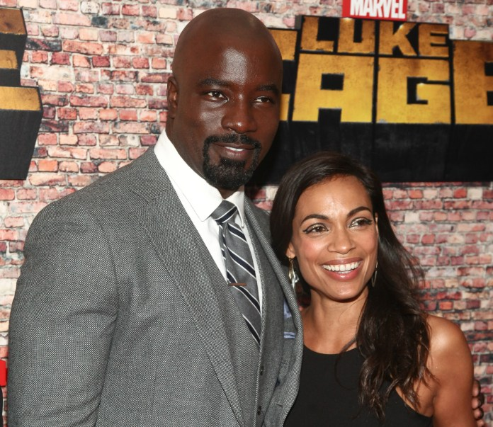 """Mike Colter, left, and Rosario Dawson, attend the Netflix's original series premiere of Marvel's """"Luke Cage"""" at the AMC Magic Johnson Harlem 9 Theater on Wednesday, Sept. 28, 2016, in New York. (Andy Kropa/Invision/AP)"""