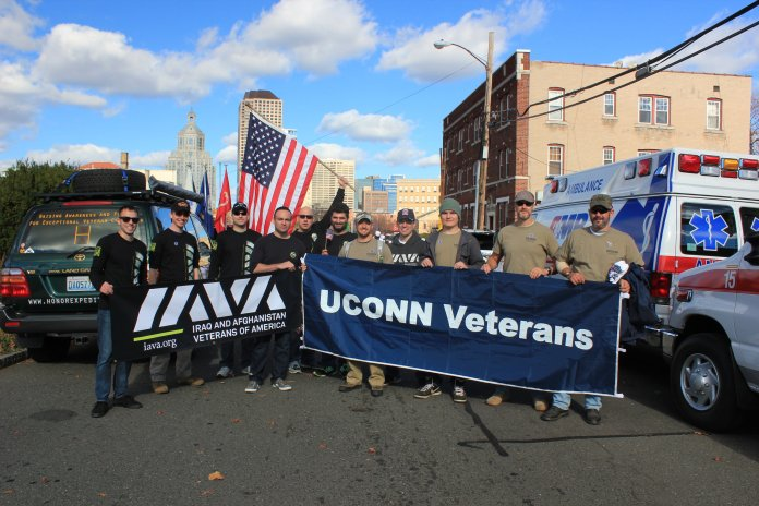UConn veterans and other veterans pose for a photo in the 2015 Hartford Veterans Day Parade. (Samuel Surowitz)
