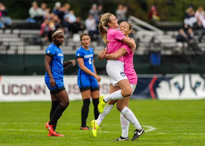 UConn senior Stephanie Ribeiro, and senior Rachel Hill embrace after scoring a goal en route to a 4-1 win over Memphis on Sunday,Oct.2, 2016. (Jason Jiang/The Daily Campus)