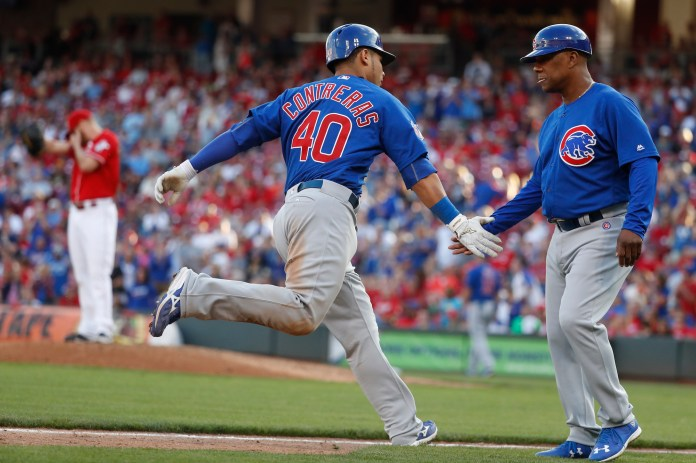 Chicago Cubs' Willson Contreras (40) celebrates with third base coach Gary Jones, right, as he runs the bases after hitting a solo home run off Cincinnati Reds relief pitcher Blake Wood in the eighth inning of a baseball game, Sunday, Oct. 2, 2016, in Cincinnati. The Cubs won 7-4. (John Minchillo/AP)
