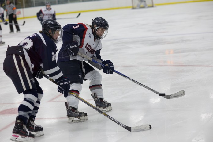 Women's hockey opens the season against Quinnipiac this weekend.  In this photo from last season, the Huskies play the University of New Hampshire. They won 4-3 in triple overtime on at the Mark Edward Freitas Ice Forum on Saturday, February 27, 2016. (Jackson Haigis/The Daily Campus)