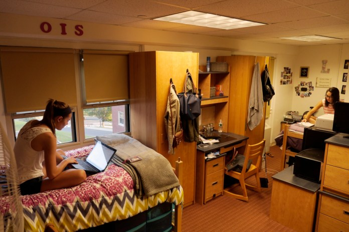 Two students in their dorm room In Northwest Residence Hall at the University of Connecticut. Resident assistants, or RAs, will now be required to maintain community hours that they're available each week in the dorms for their residents.(File Photo/The Daily Campus)