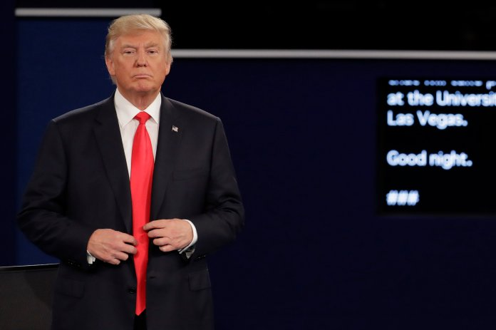 Republican presidential nominee Donald Trump buttons his jacket after the second presidential debate at Washington University in St. Louis, Sunday, Oct. 9, 2016. Juhem Navarro-Rivera, senior policy analyst at Demos, visited PRLACC ahead of the debate to talk about Trump's campaign and the 'nostalgia' some Americans have that has been brought to the surface.(AP Photo/Julio Cortez)