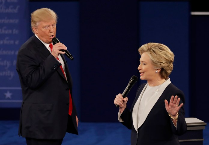 In this Sunday, Oct. 9, 2016, file photo, Republican presidential nominee Donald Trump and Democratic presidential nominee Hillary Clinton speak during the second presidential debate at Washington University in St. Louis. (Patrick Semansky, File/AP)