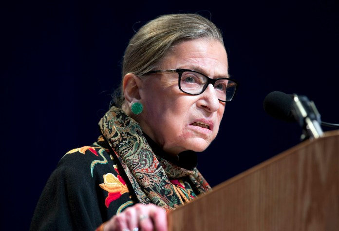 """In this Jan. 28, 2016 file photo, Supreme Court Justice Ruth Bader Ginsburg speaks at Brandeis University in Waltham, Mass. Ginsburg is calling the protests of football players who decline to stand for the national anthem """"dumb and disrespectful."""" (Michael Dwyer, File/AP)"""