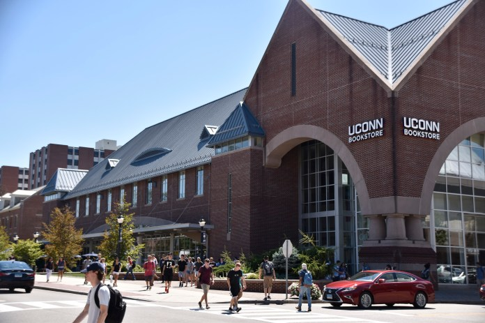 UConn students excitedly peruse the newly reopened UConn Bookstore on the first day of the 2016 Fall Semester. It is the replacement for last year's UConn Coop after the previous owners were ousted in favor of a contract with Barnes & Noble. (Grant Zither/ The Daily Campus)