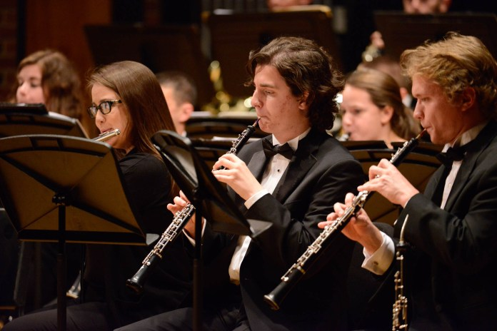 """The UConn Wind Ensemble, led by conductor and director Jeffery Renshaw, performs """"Dark Sea"""" in von der Mehdan Recital Hall on Thursday, Oct. 13, 2016. The piece payes homage to the ocean in two parts with varying themes and arrangements. (Jason Jiang/The Daily Campus)"""