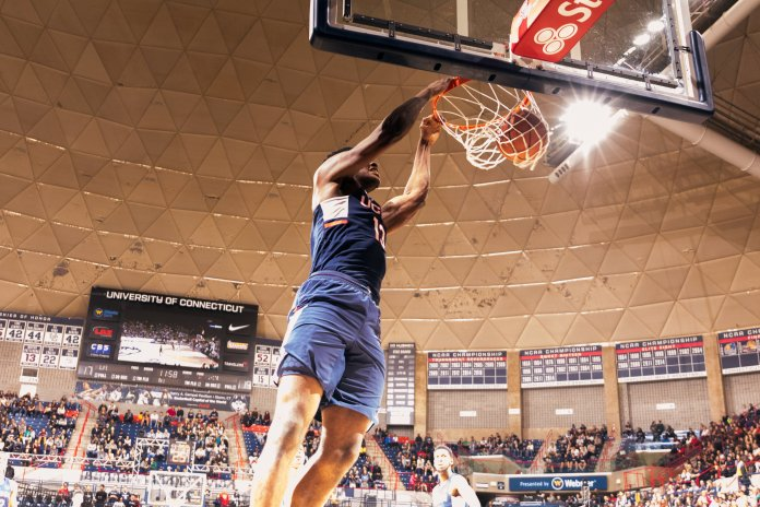Sophomore forward Steven Enoch, the dunk contest winner, slams one home.