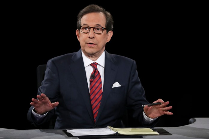 Moderator Chris Wallace of FOX News guides the discussion between Democratic presidential nominee Hillary Clinton and Republican presidential nominee Donald Trump during the third presidential debate at UNLV in Las Vegas, Wednesday, Oct. 19, 2016. (Joe Raedle/AP)