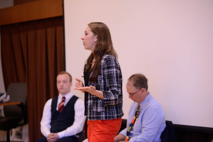Seventh semester economics and political science major Marissa Piccolo argues her point while posing as Hillary Clinton during a mock debate between Clinton and Donald Trump, played by Michael Grischuk, a fifth-semester communication major on Tuesday, Oct. 25, 2016 in Storrs Hall. The debate was hosted so journalism students in Newswriting I could ask questions about each politician's views. (Jason Jiang/The Daily Campus)