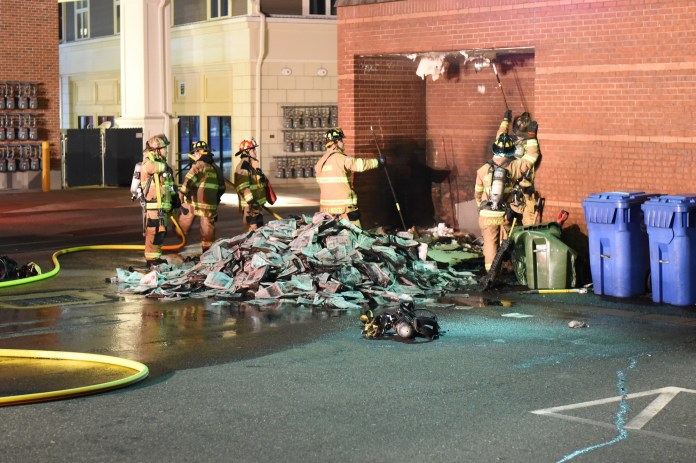 At 12:50am on Sunday, the Daily Campus newspapers caught on fire. The reason is still unknown and damage is minimal. (Charlotte Lao/The Daily Campus)