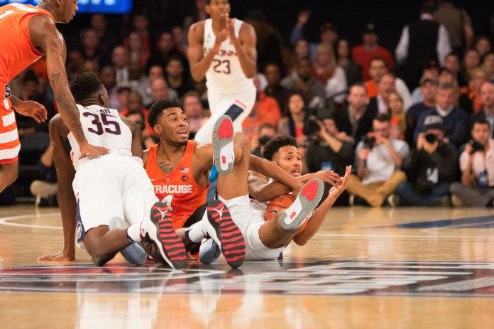 UConn sophomore Jalen Adams calls timeout after recovering a loose ball in the first half. UConn won 52-50 over Syracuse at Madison Square Garden in New York City on Monday, Dec.  5,2016.(Jackson Haigis/The Daily Campus)