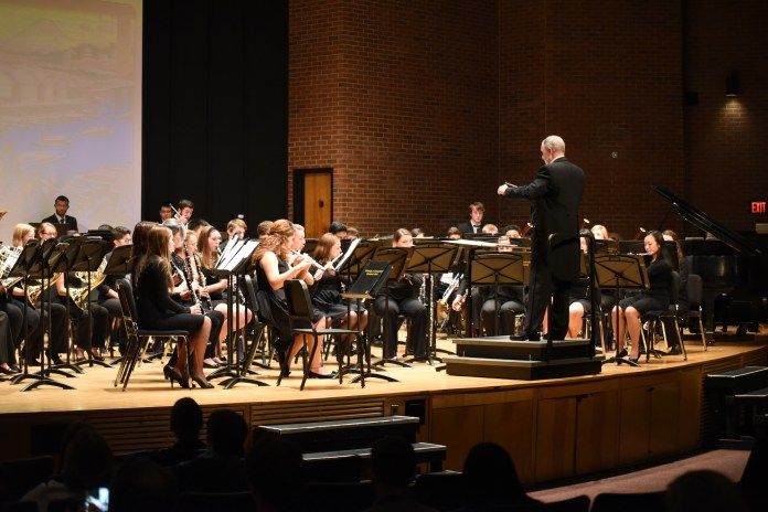 Performing Bookmarks from the World, the Symphonic Band brings the audience to different parts of the world on Tuesday night in Van Der Mehden Recital hall (Charlotte Lao/The Daily Campus)