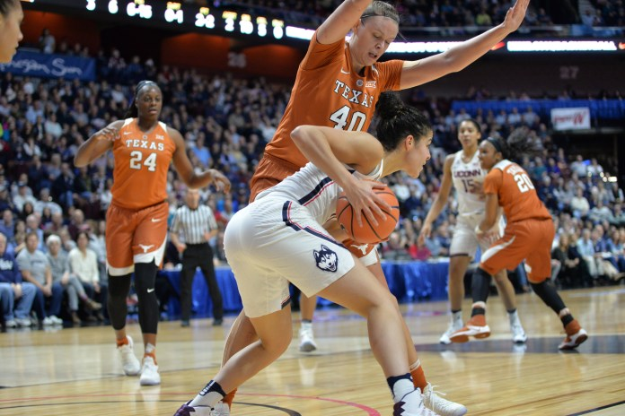 Senior guard Kia Nurse prepares looks for a teammate during the Huskies 72-54 victory over the Texas Longhorns at Mohegan Sun Arena on Sunday, Dec. 4, 2016. Nurse put up 15 points, the second highest on the team. (Amar Batra/The Daily Campus)
