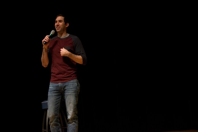 Stand up comic Michael Palascak performs in the Student Union Theatre on Wednesday, Dec.7, 2016, giving UConn students one final laugh of the semester. (Mustafe Mussa/The Daily Campus)