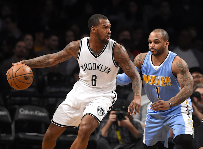 Brooklyn Nets guard Sean Kilpatrick (6) drives the ball around Denver Nuggets guard Jameer Nelson (1) in the first half of an NBA basketball game in New York, Wednesday, Dec. 7, 2016. The Nets won 116-111. (Kathy Kmonicek/AP Photo)