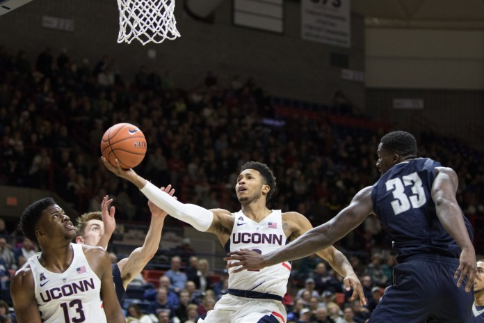 UConn point guard Jalen Adams drives to the hoop in the Huskies' 80-59 win over North Florida on Dec. 18, 2016 at Gampel Pavilion (Jackson Haigis/The Daily Campus)