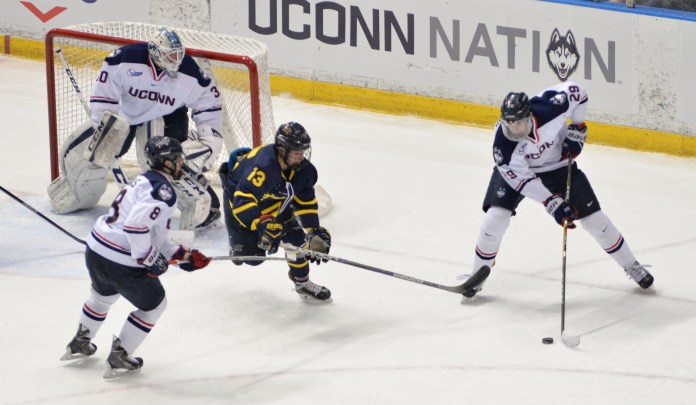 Sophomore forward,Tage Thompson(29), fights Brett Seney(13) in the Huskies' February 4th game against Merrimack at the XL Center. (Amar Batra/The Daily Campus)