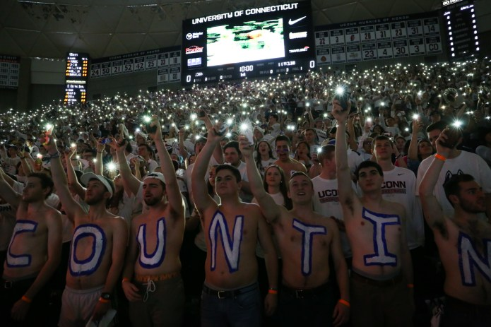 Students hold their cell phone flashlights for the national anthem.(Jackson Haigis/The Daily Campus)