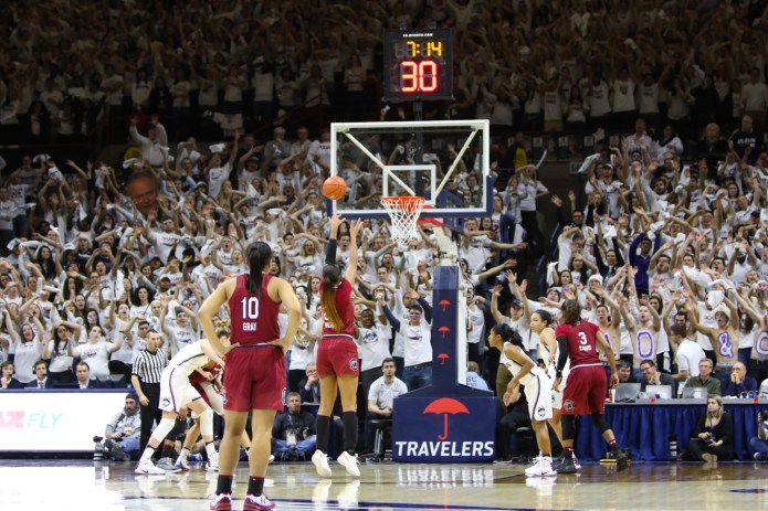 The student section attempts to distract South Carolina's A'ja Wilson while shooting a free throw.(Jackson Haigis/The Daily Campus)