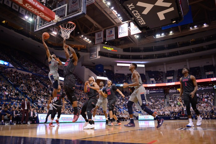 UConn senior Rodney Purvis (15) completes a lay-up during the Huskies loss to SMU on Feb. 25, 2017. Purvis along with Kentan Facey and Amida Brimah (both pictured above) will be honored at a senior ceremony on Sunday. (Jason Jiang/The Daily Campus)