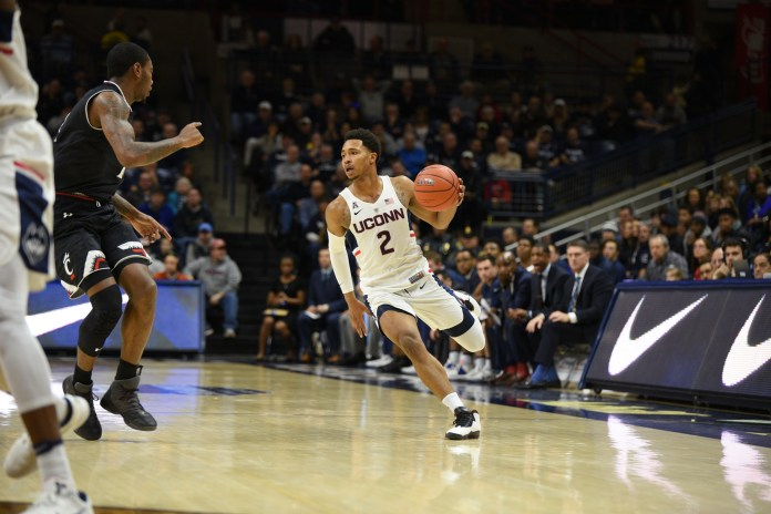Jalen Adams looks for a passing lane during the Huskies 67-47 loss to Cincinnati on Sunday, March 5, 2017. (Zhelun Lang/The Daily Campus)