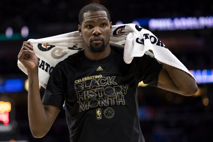 In this Monday, Feb. 27, 2017, photo, Golden State Warriors' Kevin Durant looks on during the second half of an NBA basketball game against the Philadelphia 76ers in Philadelphia. The Warriors say n Durant will be out indefinitely after he sprained the medial collateral ligament in his left knee and bruised a bone in his leg. (Chris Szagola/AP)