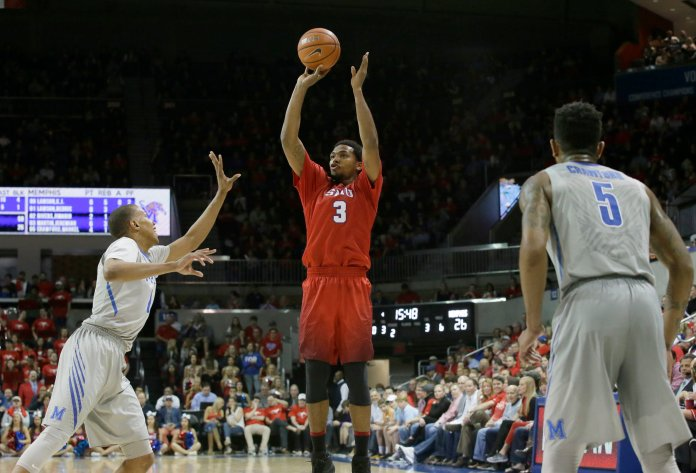 SMU guard Sterling Brown (3) shoots against against Memphis defenders Dedric Lawson (1) and Markel Crawford (5) during the second half of an NCAA college basketball Saturday, March 4, 2017, in Dallas.SMU won 103-62. (LM Otero/AP)