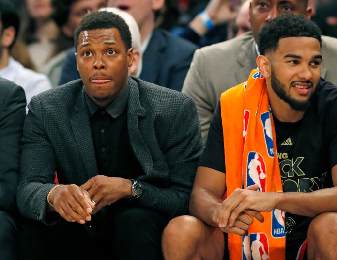 Toronto Raptors Kyle Lowry, who is out with a right wrist injury, sits beside Raptors guard Cory Joseph on the bench during the first half of an NBA basketball game against the New York Knicks at Madison Square Garden in New York, Monday, Feb. 27, 2017.Lowry is scheduled to have surgery on his wrist Tuesday. (Kathy Willens/AP)