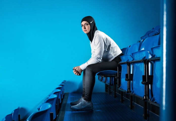 In this undated image provided by Nike, figure skater Zahra Lari model wears Nike's new hijab for Muslim female athletes. The pull-on hijab is made of light, stretchy fabric that includes tiny holes for breathability and an elongated back so it will not come untucked.(Nike/AP Exchange)