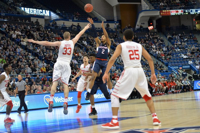 Jalen Adams takes a shot against Houston's Kyle Meyer (33) in UConn's 74-65 win over Houston in the second round of the American Athletic Conference tournament on Friday, March 10, 2017 at the XL Center in Hartford. (Amar Batra/The Daily Campus)