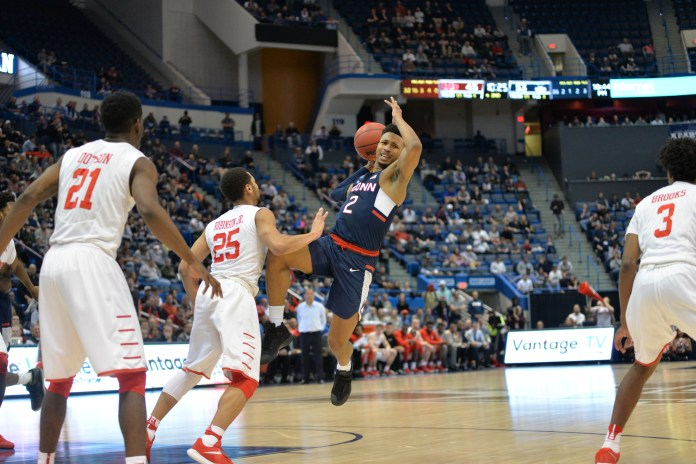 Jalen Adams protects the ball against Houston's Galen Robinson Jr. (25)in UConn's 74-65 win over Houston in the second round of the American Athletic Conference tournament on Friday, March 10, 2017 at the XL Center in Hartford. (Amar Batra/The Daily Campus)