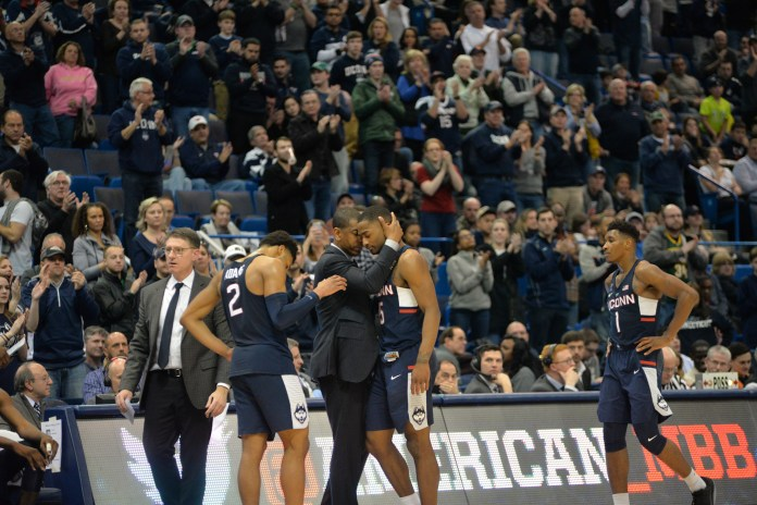 Senior Rodney Purvis is consoled by head coach Kevin Ollie during UConn's American Tournament loss to Cincinnati. (Amar Batra/The Daily Campus)