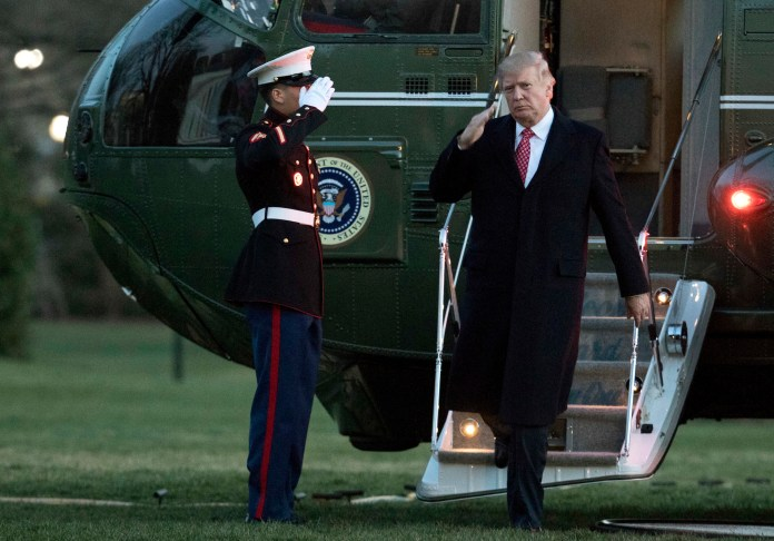 President Donald Trump salutes as he disembarks Marine One upon arrival at the White House in Washington, Sunday, March 5, 2017. (Manuel Balce Ceneta/AP Exchange)