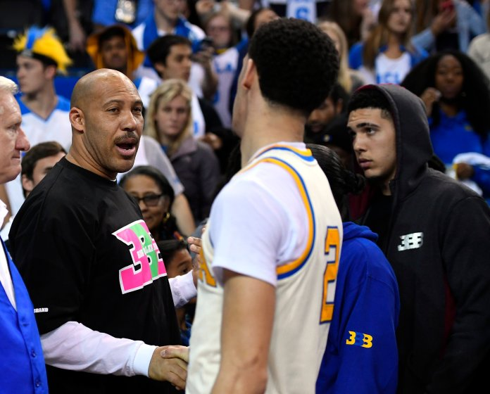 In this March 4, 2017, file photo, UCLA guard Lonzo Ball, right, shakes hands with his father LaVar following an NCAA college basketball game against Washington State in Los Angeles. UCLA won 77-68.LaVar Ball says his home was broken into while he was attending a high school game involving two of Lonzo Ball's brothers. (AP Photo/Mark J. Terrill, File)