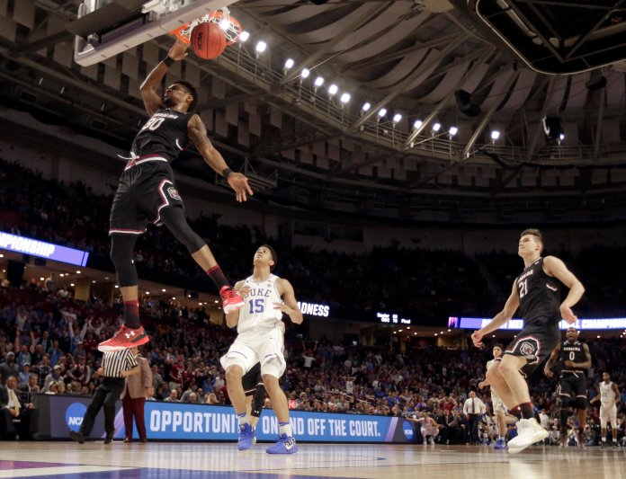 South Carolina's Chris Silva (30) dunks against Duke's Frank Jackson (15) during the second half in a second-round game of the NCAA men's college basketball tournament in Greenville, S.C., Sunday, March 19, 2017. (AP Photo/Rainier Ehrhardt)