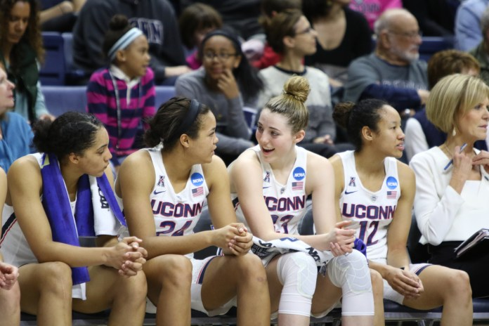 UConn's Gabby Williams, Napheesa Collier, Katie Lou Samuelson and Saniya Chong sit on the bench during the victory over Syracuse. (Jackson Haigis/The Daily Campus)