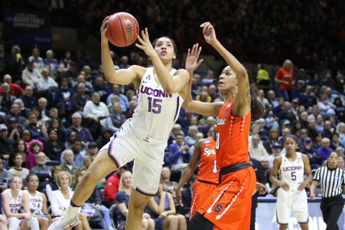 Gabby Williams (15) completes a layup during the Huskies 94-64 victory over the Syracuse Orange in Gampel Pavilion on Monday, March 20, 2017. The victory moved the Huskies into their 24th-straight Sweet 16. (Jackson Haigis/The Daily Campus)