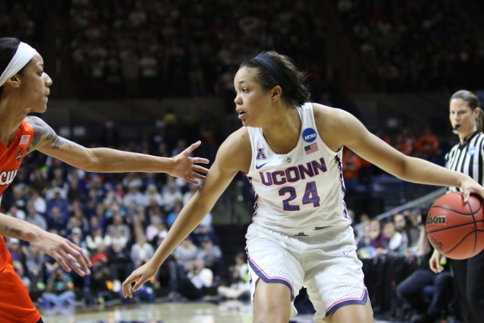 Napheesa Collier looks for an open passing route during the Huskies 94-64 victory over the Syracuse Orange on Monday, March 20, 2017 in Gampel Pavilion. (Jackson Haigis/The Daily Campus)