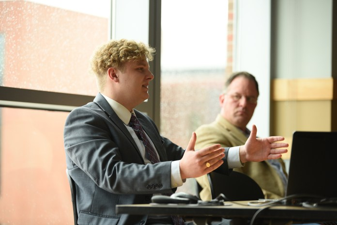 Former Army service member and current UConn student, Michael Bidwell, and Navy Veteran Bob Hunter, boldly share their stories and discuss the effects of military sexual trauma. (Zhelun Lang/The Daily Campus)